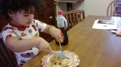 Enjoying the fruits of her labor. My toddler, who also has 2 older siblings, tends to want to do everything herself, even cutting her food. So allowing her to use a plastic knife of a dull knife to cut her own pancakes helps her feel like one of the big kids. It is a learning process and she will ask for help when she needs it.