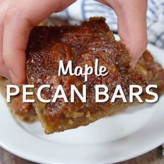 Maple Pecan Bars - So addicting! They are a cross between a butter tart and pecan pie. Maple Pecan Bars - So addicting! They are a cross between a butter tart and pecan pie. Pecan Recipes, Sweet Recipes, Cookie Recipes, Dessert Recipes, Easy Desserts, Delicious Desserts, Yummy Food, Pecan Desserts, Pecan Bars