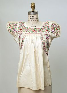 Mexican traditional blouse. 1945-1950. Ivory cotton with lace insets and intricate multi-color floral silk embroidery. Photo: The MET Museum