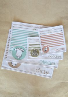 Diaper Bag Organizer Pouches 22.99 at shopruche.com. This set of four cotton diaper bag pouches in ivory are designed with zipper closures, sheer mesh backs, and pastel designs to help organize your diaper bag. Includes pouches for clean clothes, dirty clothes, goodies, and extras. Machine washable.100% Cotton...