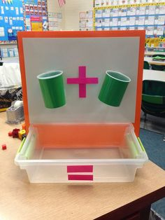 Math- Addition Cups! Cups have holes in them so that the manipulative a drop through. The kids use white board markers to write the numbers.