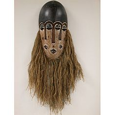 Product Features: All masks are not carved equal Emma responded to an in-house challenge to create a mask with a decorating charm and an old world feel Antique-finish tribal mask features a burlap jut