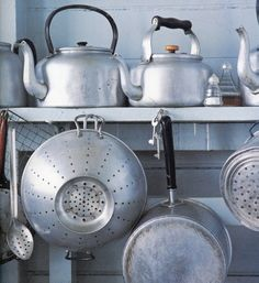 Vintage kitchen ware - pots, kettles, strainers and spoons.