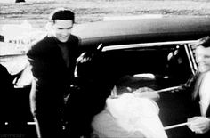 Elvis and Priscilla Presley, accompanied by Vernon Presley and Charlie Hodge, welcome home five-day-old Lisa Marie to Graceland, February 5, 1968