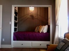Bed in closet w/ shelves