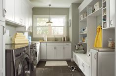 I love the combo laundry/mud room.  Needs more coat storage... maybe lose the shelves above the bench.