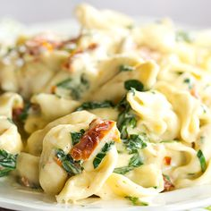 Cheese tortellini are tossed in a garlic-Parmesan cream sauce with spinach and sun-dried tomatoes. An easy dinner ready in less than 30 minutes!