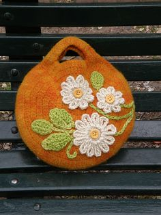 Love the crocheted flowers on this bag. And the buttons. And the bag :) Although not a huge fan of orange.