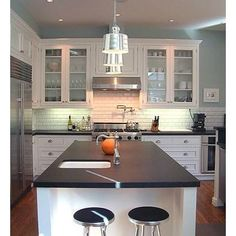 Kitchen - Dark granite countertop - white cabinets - blue green paint color