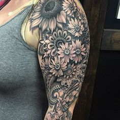 Today, millions of people have tattoos. From different cultures to pop culture enthusiasts, many people have one or several tattoos on their bodies. While a lot of other people have shunned tattoos… Mandala Tattoo Sleeve, Sunflower Tattoo Sleeve, Sunflower Tattoo Shoulder, Flower Sleeve, Sunflower Tattoos, Lace Tattoo, Tattoo Sleeve Designs, Tattoo Flowers, Sunflower Mandala Tattoo