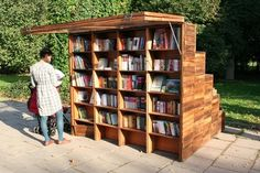 Enticed by the bookstand's offerings, one reader picks and chooses, casually using the awning as a sunshade. Photo courtesy of Ruetemple Architectural Studio. Photo 3 of 9 in Innovative Outdoor Libraries in Russia by Jacqueline Leahy Little Free Libraries, Little Library, Free Library, Mobile Library, Space Books, Lending Library, Urban Furniture, Pvc Furniture, Furniture Online