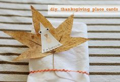 Make little Turkey DIY Thanksgiving Place cards from pressed leaves and triangles via Cool Progeny.