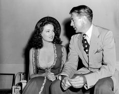 A Spotty Tie. Gary Cooper, with Gene Tierney, 1941.