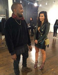 kanye west and kim kardashian. kim looks amazing here.