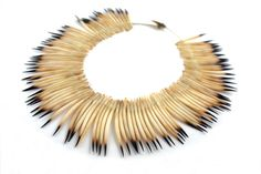 necklace : Echidna quills ( Jeanette James is a Tasmanian aboriginal artist who grew up with her mother, Aboriginal artist Corrie Fullard, in northern Tasmania. She spent her early years walking the beaches of the island collecting shells ) Tribal Jewelry, Jewelry Art, Beaded Jewelry, Jewellery Box, Feather Necklaces, Shell Necklaces, Aboriginal Artists, Echidna, Animal Bones