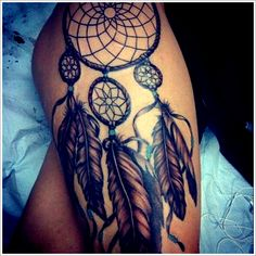 Elegant Dreamcatcher Tattoo on Thigh