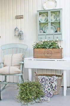 Cottage style. Love the cabinet on the wall. Soft colors.