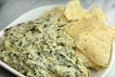 Instant Pot Artichoke and Spinach dip that is an Applebees copycat recipe. If you love their creamy dip, then you will love this recipe.