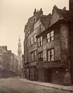 1bohemian:  A man turns to look back in Drury Lane, 1876.