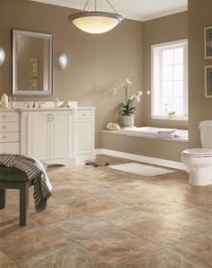 Luxury vinyl is water resistant and easy to clean, making it ideal for bathrooms.