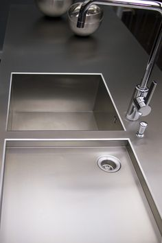 Inox sink and worktop in one piece only.