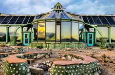 Earthships, created by architect Mike Reynolds, are houses constructed with a combination of natural and recycled material that have been built for minimal reliance on public utilities or fossil fuels.