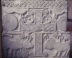 Lombard art; 8th-century relief from a chancel barrier; cross, interlace, and evangelist symbols; Pisa, Museo Nazionale