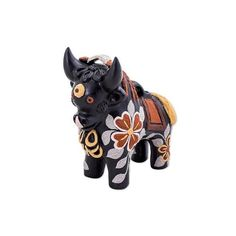 NOVICA Matte Black Hand Painted Ceramic Bull Figurine ($90) ❤ liked on Polyvore featuring home, home decor, black, clothing & accessories, sculpture, ceramic sculpture, floral sculpture, black home decor, black figurines and handmade home decor