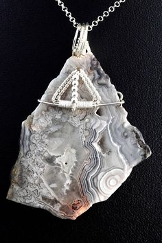 A unique, handmade, wire wrapped pendant with Crazy Lace Agate.  Pendant was designed and made by Me, using an extremely labor-intensive and precise wire-wrapping technique, with sterling silver 925, 930 and 999.  Dimensions of pendant: length: 6.3 cm 2.48 inch width: 4.3 cm 1.69 inch  You receive this unique pendant in jewelry box, so it is ready to be a gift.  ---On this auction You buy pendant with brown leather strap ( 47 cm 18.5 inch ).----   Refunds and Exchanges:  If you are not…