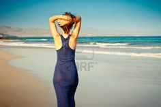 Young woman posing on the beach Stock Photo