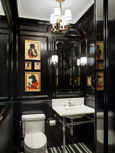 classico-bagno-di-servizio: Here are some more black bathrooms. Black or a deep rich color is great for a powder room or small bathroom. It's a great place to experiment with something dramatic. The payoff is huge!