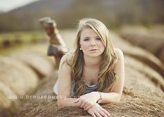 Cool Country senior/School picture... She's on hay bales! Such a cool idea and effect!!