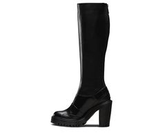 This is the Lyanna, a totally new knee-high boot with a full-length zipper up the back of the calf. It's got the same durable ass-kicking aggressive style as the original Dr. Martens boots; we just added some xx chromosomes to the DNA. Extra height and goth street cred come in the form of a chunky, edgy heel. And that's balanced out by a sleek, easy-on-and-off design. There's no other way to say it: this is a sexy boot. The Lyanna has all the classic Doc DNA, like yellow stitching, grooved…