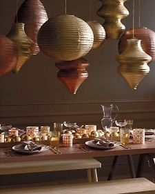 Spray paint paper lanterns with gold and bronze Krylon spray paint.