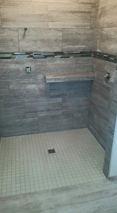 Custom Tile Shower With Two Vertical Stone And Glass Tile