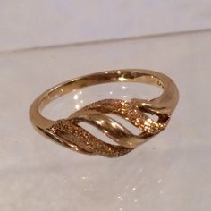 A personal favorite from my Etsy shop https://www.etsy.com/listing/244144681/10k-gold-twist-dome-style-band-ring-fine