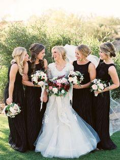featured photographer: Erich McVey; Chic black bridesmaid dress idea