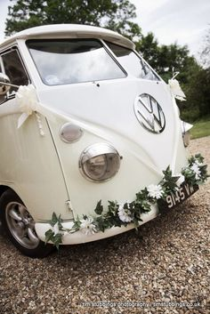 Decorated VW camper van bumbers with wedding flowers. Photography by Kent wedding photographer Tim Stubbings http://www.timstubbings.co.uk