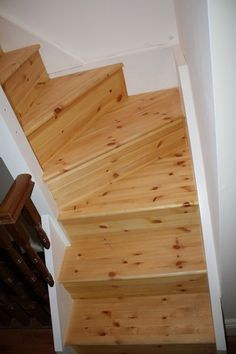 Double winder staircase in red deal leading to attic. Turned Newel posts & Spindles