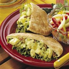 Curried Chicken Pitas Recipe -These pitas are a nice change of pace that pack a satisfying punch. Chicken, pecans and touches of honey and curry make this festive favorite just as tasty when wrapped in tortillas or served over crisp greens. —Marilou Robinson, Portland, Oregon