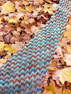 Rise and Fall is created using an undulating chevron stitch pattern and a gradient in both color and shape, which makes the design both interesting to knit and to look at.