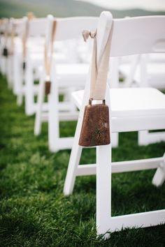 Vintage cow bells (aisle decoration) - Pippin Hill Farm Wedding from Andrea Hubbell Photography