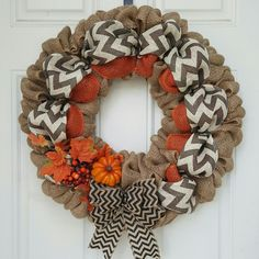 "This Beautiful Burlap wreath averages 18"". Grey Chevron and Orange burlap, Black Chevron Bow, and small Orange pumpkin adds a welcoming accent to any front door!"