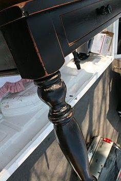 Distressed black harvest table                                                                                                                                                                                 More