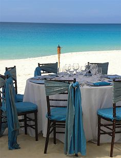 Turquoise chair wraps #turquoise #wedding  #decor