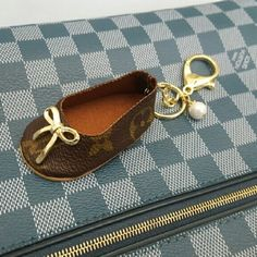 Shoe charm keychain Unique handbag charm or keychain upcycled from 100% authentic Louis Vuitton canvas.  I can adjust the clip size if you prefer a smaller clip or just a key ring.  This was handmade with LVoe :)  Price is firm. Louis Vuitton Accessories