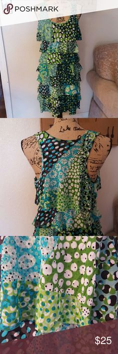 """Kenneth Cole tank ruffle dress sz LG Very fun ruffle racer back tank dress! Multi patterned dress in size LG, it has only we been worn a few times. I'm 5'3"""" and it hits about 3"""" above my knees but also large chested so that makes the dress shorter. Great condition, comes from a smoke and pet free home. Kenneth Cole Dresses"""