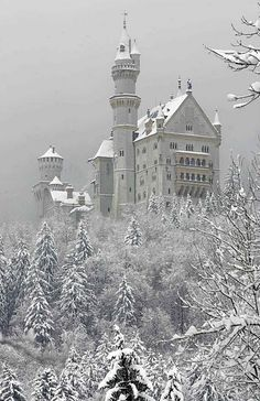 """SCHWANGAU, Germany: The """"fairy tale"""" castle Neuschwanstein is seen 05 March 2006 in the snow covered landscape in Schwangau, Bavaria. The castle was rebuilt by the King of Bavaria from 1864 to 1886, and was opened to the public seven weeks after the death of King Ludwig II in 1886. Today Neuschwanstein is one of the most popular palaces in Europe. AFP PHOTO DDP/JOHANNES SIMON GERMANY OUT (Photo credit should read JOHANNES SIMON/AFP/Getty Images)"""