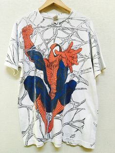 1994 SPIDERMAN Allover Print Oversized Vintage T Shirt // Size Large by GrungyGarbs on Etsy https://www.etsy.com/listing/458193850/1994-spiderman-allover-print-oversized