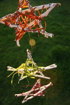 Summer Stars - patio ornaments: painted twigs wrapped in raffia - happy hooligans